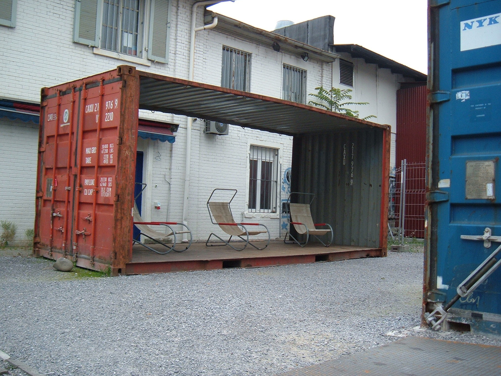 Ten recycled shipping container buildings recyclenation for Hive container homes