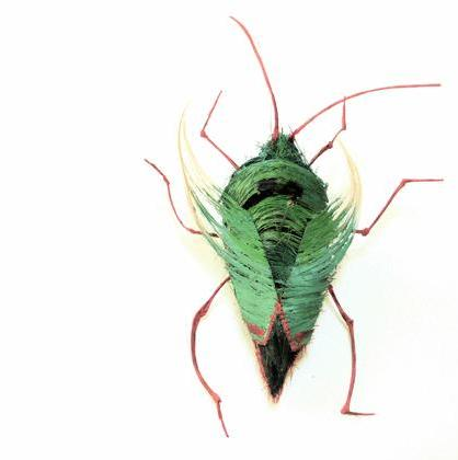 green and red beetle Insects Created from Recycled Human Hair