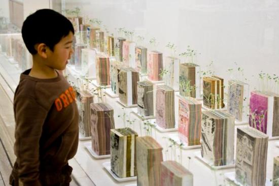 boy with mangas When Plants Grow Out of Old Manga Comics