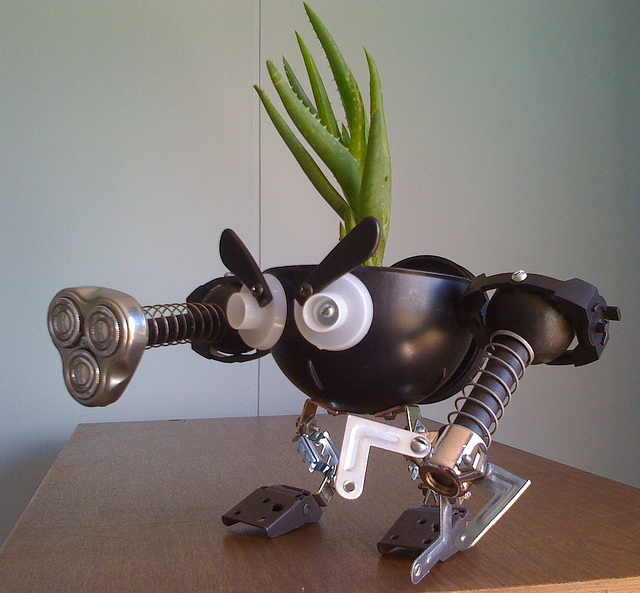 recycled robo planter people
