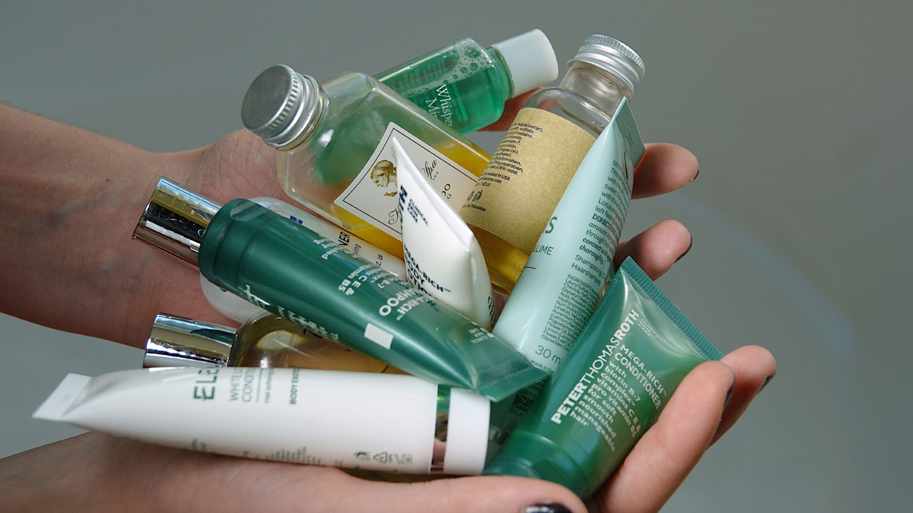 Photo of someone holding various single-use personal care products.